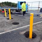 Labourer Dave Arthur works on John Wilson Ocean Dr, where contractors are installing bollards to...