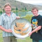 Lake Dunstan Boat Club regatta points officer Dave Robertson (left) presents Matthew Pope, of...