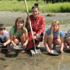 Lakes District Museum education officer Amy Taylor practises gold panning in the Arrow River with...
