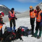LandSAR members Emma Fleming, John Taylor, Rod Walker and Alan Gillespie prepare to search for a...