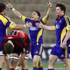 Highlanders first five-eighth Daniel Bowden (centre) celebrates with team-mate Tim Boys (right)...