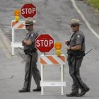 Law enforcement officers work a roadblock on the perimeter of a search area for David Sweat south...