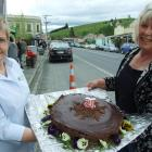 Lawrence Information Centre staff member Elsie Thompson (left) and cake-maker Kelly Aitken...