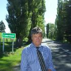 Lawrence-Tuapeka Community Board chairman Geoff Davidson with  the Lombardy poplars which line...