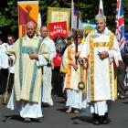Leading a procession marking 150 years since the laying of the foundation stone at Dunedin's All ...