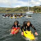 Leading the way during a Surf Life Saving Otago training camp paddling technique lesson at the...