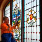 Leadlights & Lamps owner Kevin Casey gets ready yesterday to dismantle the damaged leadlight...