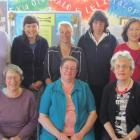 Learning to speak English by singing at Literacy North Otago are, standing, from left, Yumi...