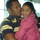 Highlanders midfield back Johnny Leota is greeted by daughter Brooklyn (5) at Dunedin Airport. ...