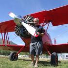 Les Lamb stands beside the biplane which has been creating plenty of interest at the Omarama...
