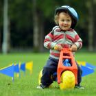 Lewis Maclennan (2), of Dunedin, has a test drive of the Stride, Ride and Slide course at the...