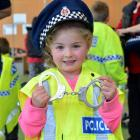 Lilly Georgeou (5) tries on a police uniform during the National Police Open Day at the Dunedin...