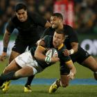 Lima Sopoaga tackles South African counterpart Handre Pollard at Ellis Park in Johannesburg....
