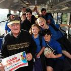Lindsay Wright (front) and Balclutha Primary School pupils on his bus yesterday celebrate his big...