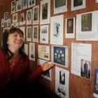 Linda Wigley, director of the Otago Settlers Museum, admires photographs provided for the museum...