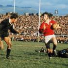 Lions fullback JPR Williams  takes on All Black flanker Ian Kirkpatrick during a test on the tour...