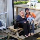 Lisa Ferguson, Nathan Jackson and son Regan (1) expect they will have to sell their first home to...