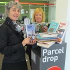 Literacy North Otago manager Helen Jansen and NZ PostShop Oamaru manager Sandy Ballantyne with...