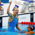 Lithuania's Ruta Meilutyte (L) celebrates after winning the women's 100m breaststroke final at...