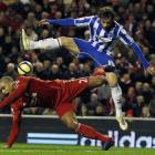 Liverpool's Glen Johnson challenges Brighton and Hove Albion's Ingo Calderon. REUTERS/Phil Noble