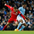 Liverpool's Lucas Leiva vies for the ball with Manchester City's Raheem Sterling. Photo: Reuters