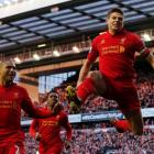 Liverpool's Steven Gerrard (R) celebrates scoring against Tottenham Hotspur during their English...