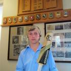 Llewellyn Johnson under the Waitaki Boys' High School honours board. Photo by Andrew Ashton.