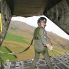 Loadmaster Sergeant Rodrigo Arriagada ventures to the end of the plane after the load is dropped....