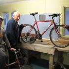 Local bike technician Jimmy Pollard, Neil McArthur, of the Alexandra men's shed group, and Thyme...