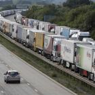 Lorries are backed up on the M20 motorway which leads from London to the Channel Tunnel terminal...