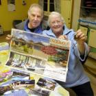 Cliff and Valerie Hall show the promotional material for the Queensland house they have won in a...