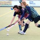 Louise Lin (Logan Park), left, and Connie McDonald (Columba) battle for possession in a secondary...