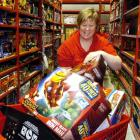 Lynda Crawford, of Balclutha, fills several trolleys with toys yesterday during a two-minute ...