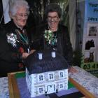 Lynda Snell (84) and Ruth Telford (84) cut the cake at the opening of Telford: the Golden Years...
