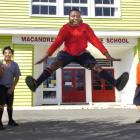 M-slaks hip-hop team member Marvelous Bamgbose (13) jumps for joy, watched by (from left) Isaac...