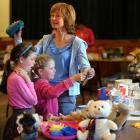 Madeline Bilkey (9, left),  Annabel Bilkey (8) and Christine Parker, all of Dunedin, hunt for...