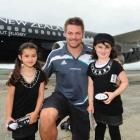 Maia (5, left) and Zoe Halls (8) meet All Black captain Richie McCaw at Dunedin International...