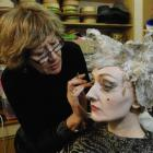 Makeup artist Marie Huston turns Alethea Chittenden into Grizabella. Photo by Linda Robertson.