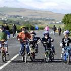 Making the most of a car-free John Wilson Ocean Dr, Dunedin, yesterday are (from left) Josh (7),...