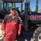 Malcolm Taylor unloads his tractor at Olds College in Alberta, Canada, in preparation for the...