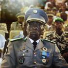Malian coup leader Captain Amadou Sanogo attends a ceremony as former Parliament speaker...