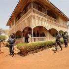 Malian junta soldiers walk in the yard of their headquarters in Kati, outside Mali's capital...