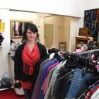 Manager Yvonne Shields prepares to welcome customers to the Inside Out clothing store, one of 10...