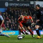 Manchester City's Carlos Tevez (R) goes past Aston Villa goalkeeper Brad Guzan (C) to score...