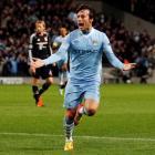 Manchester City's David Silva celebrates scoring against Bayern Munich in their Champions League...