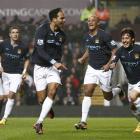 Manchester City's Joleon Lescott celebrates after scoring against Aston Villa. (AP Photo/Jon Super)