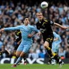 Manchester City's Samir Nasri (L) challenges Bolton Wanderers' David Wheater during their Premier...