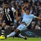 Manchester City's Vincent Kompany challenges Newcastle United's Hatem Ben Arfa. REUTERS/Nigel Roddis