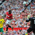 Manchester United's Anderson (C) heads to score as Norwich City's Anthony Pilkington and...