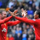 Manchester United's Antonio Valencia (R) celebrates scoring with teammate Wayne Rooney against...